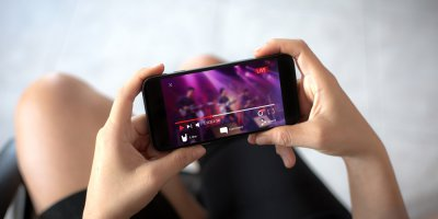 a person livestreaming video on their mobile phone