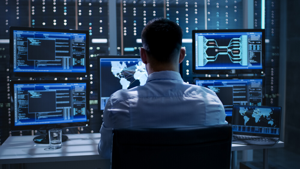 a man working in a surveillance control room